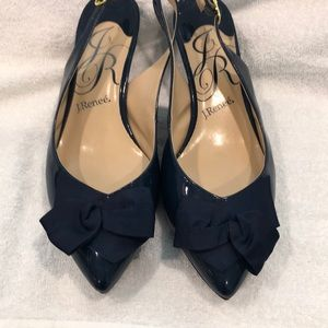 Navy patent leather shoes.
